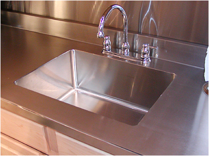 a beautiful kitchen custom made sinks and counters of